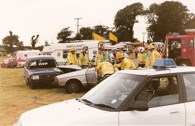 """""""Wheels"""", Plymouth Traffic Unit's annual Classic Car Show charity fund raiser at Lyneham House. This was a supposed emergency services demonstration of collision attendance. I'm supposedly first-on-scene and now relegated to holding an IV drip while """"Trumpton"""" destroy the car."""