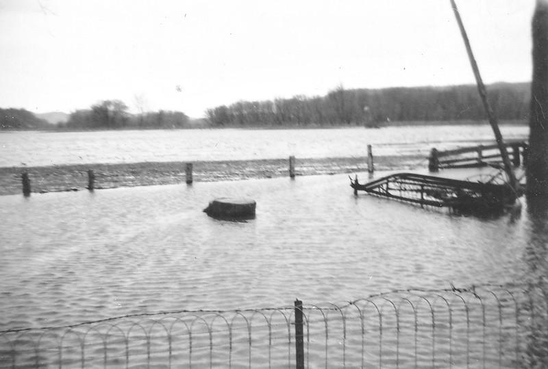 Joe and Vernie Von Arx's flooded farm by Hokah, MN.  Other side of coffee shop - Goe's side rake half under water.