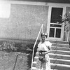 Irene Von Arx - outside the back entrance to the house in Hokah.  (Although that is the entrance that was always used :-)