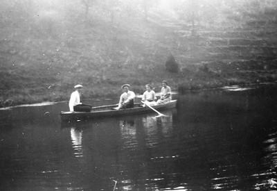 Joe and Vernie Von Arx in center of boat?  Marie Langen in back?