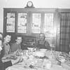 Birthday party for Irene.  Starting front left and around the table:  Georgina Tschumper, ______, _______, Marian Murray, Irene Von Arx, Joe (Josie) Von Arx, Pauline Truempi, Mary Volk, and possibly Agnes Murray.