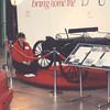 Deb York with Duryea exhibit at Peoria Civic Center