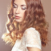 Glamour portrait of beautiful woman model with fresh makeup and romantic wavy hairstyle