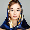 Portrait of of young beautiful woman with a scarf on head