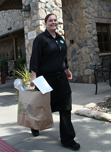 Lisa Mutnansky of Olive Garden in Elyria, helps to deliver a free Labor Day Lunch to the Elyria Police Department. photo by Ray Riedel