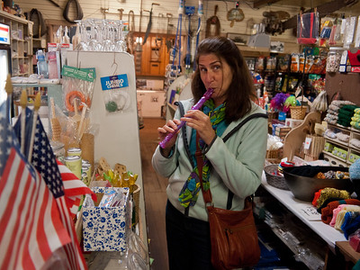 Vicki playing with a plastic recorder in the Joyce General Store.