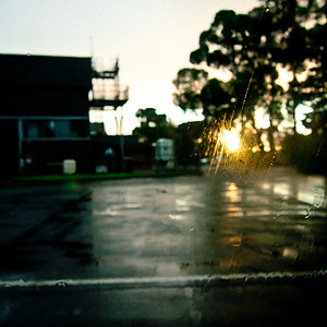 Trying to capture sun flare against a wet car window