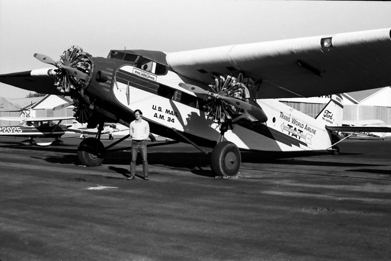 THE FORD TRIMOTOR AND ME<br /> Santa Paula Airport, Santa Paula, California - early 1970s<br /> <br /> I went out to Santa Paula Airport one weekend, as I was often given to do, and came across one of these antique behemoths that I love so much, so I couldn't help but take a photo of me with it. I still want a ride in one of these someday.