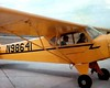 FIRST FLYING LESSON<br /> Grand Prairie Airport, Grand Prairie, Texas<br /> <br /> That's me in the back seat of this Piper J3 Cub, about to go out on my first flying lesson. The guy in the front is Carl Frenzel, who would become my flight instructor when I took up lessons for real the summer after High School graduation. This would be one of the hairiest takeoffs of my flying career. I kept at it, though.