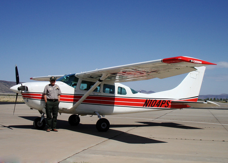 "CURTIS AND ""FOUR PAPA SIERRA""<br /> Here's where another little adventure got its start-- at the Casparis Airport in Alpine, Texas, one of my favorite haunts. The pilot, Curtis (seen here), and his assistant, Howard, had stopped in to refuel N104PS, known in radio lingo as ""Four Papa Sierra"" (the last three digits of its N-number), and I just happened along shortly afterward. I got to chatting him up and the next thing I knew, I'd gotten myself invited along for a flight the next day -- if the park was going to need him to fly a patrol sweep, that is. Turned out it did, and we were set."
