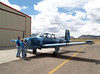 "N234MD GETS HAULED OUTSIDE<br /> Casparis Airport, Alpine, Texas<br /> <br /> While rambling around Casparis Airport one day, I ran across these folks, JD and Michele Daniels, who own several Beechcraft T-34A Mentors. After a lot of ""hangar flying"" that day, thay asked me if I'd be willing to photograph JD's ""Thunderbird"" T-34 from the air for them, and of couse my answer was an enthusiastic ""YES!"" We set the date, and here are JD and Michele towing her beautiful plane outside and into position. This would be the camera ship, with Michele flying and me in the back seat firing furiously and grinning to beat the band."