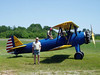 THE HAPPY GUY<br /> Owls Head Transportation Museum, Rockland, Maine - July 2005<br /> <br /> A shot of me in front of the Stearman, with the pilot looking on. I've always been sorry I didn't even bother to find out his name.