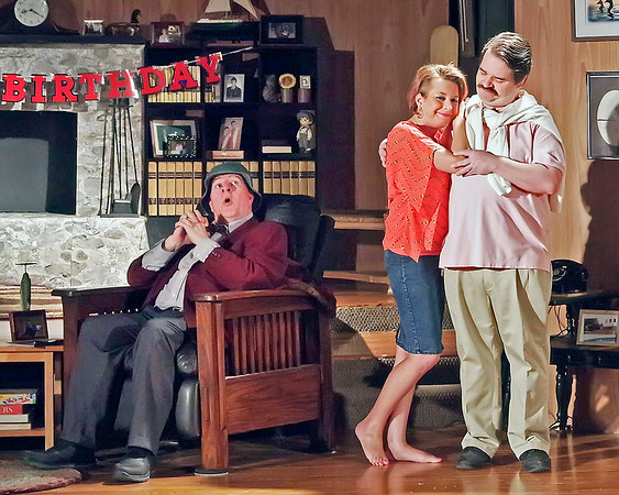 Mark Maynard | for The Herald Bulletin<br /> Norman (Bob Green) reacts as Chelsea (Wendy Carpenter) and Bill (Shaun Berkey) display their affection for each other.