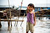 A young girl in the Chong Kneas floating village near Siem Reap in Cambodia (photo by Ivy Lam)