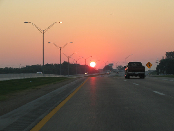 As I drove out of Dallas, a giant red Sun hovered over the distant horizon