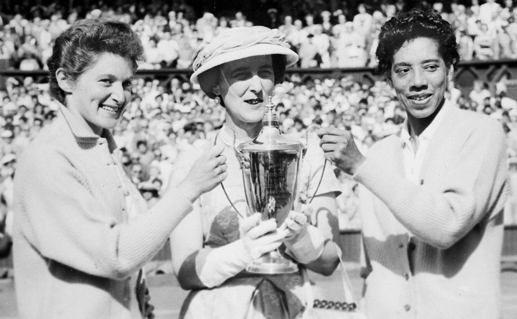 . The Duchess of Kent, center, presents the trophy for the Ladies\' Doubles title to Angela Buxton, left, and Althea Gibson, right, following their victory at Wimbledon, England, July 7, 1956. They defeated the Australian team of Fay Muller and Daphne Seeney, 6-1, 8-6. (AP Photo)