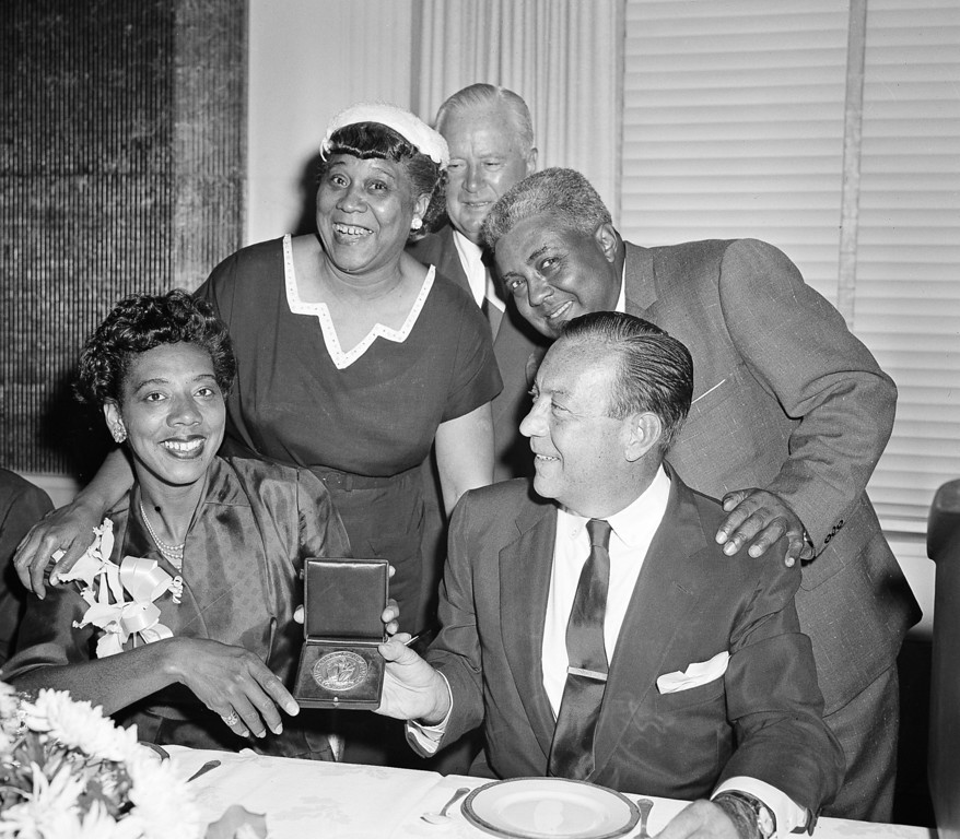 . New York\'s Althea Gibson and Australia\'s Mal Anderson hold their trophies after their victories in the National Tennis Championships at Forest Hills, N.Y., Sept. 8, 1957.  Others are unidentified.  (AP Photo/Harry Harris)