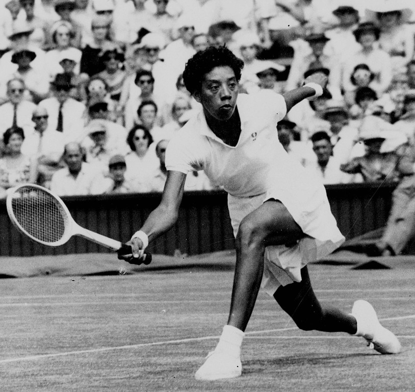 . Althea Gibson makes a low return to Darlene Hard during their title match at Wimbledon July 6, 1957.  Gibson claimed the women\'s singles tennis title at Wimbledon and became the first African American to win a championship. (AP Photo)