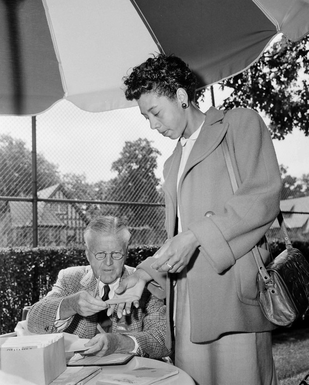 . Tennis Star, Althea Gibson, signs in for the National Tennis Championships at the West Side Tennis Club in Forest Hills, N.Y., Aug. 31, 1956. (AP Photo)