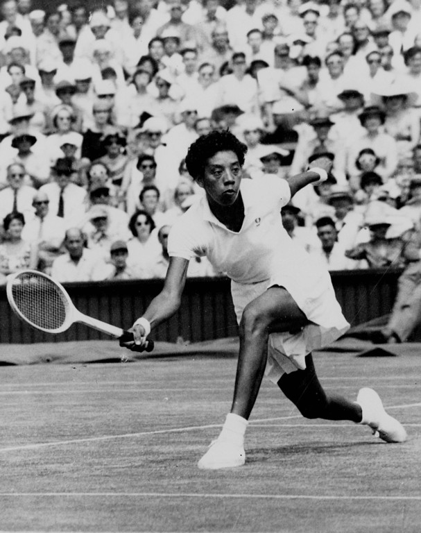 . Althea Gibson makes a low return to Darlene Hard during their title match at Wimbledon July 6, 1957.  Gibson won 6-3, 6-2. (AP Photo)