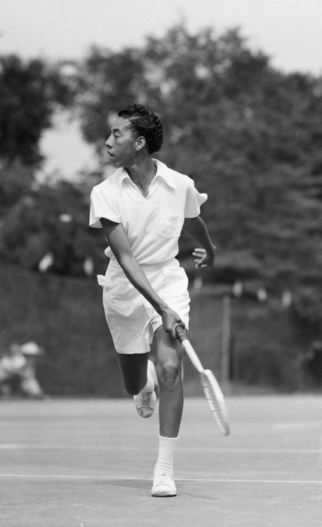 . Tennis player Althea Gibson of Tallahassee, Fla., completes a return in her first round of play against Mela Ramirez, the Mexican women\'s champ, July 18, 1950 in River Forest, Ill.  Ms. Gibson won, 6-3 and 6-1.  (AP Photo)