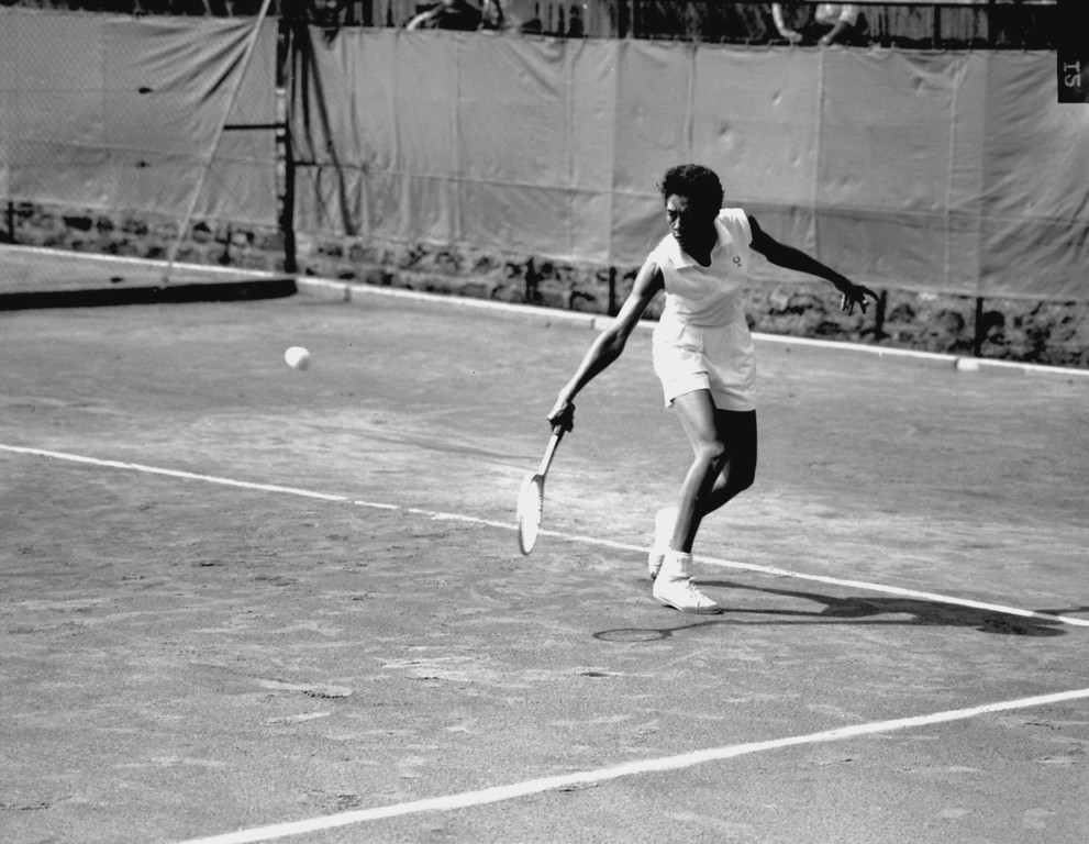 . American champion Althea Gibson is shown in action at the International  Championship of Tennis at the Roland-Petit court near Paris, France, on May 18, 1956. (AP Photo)