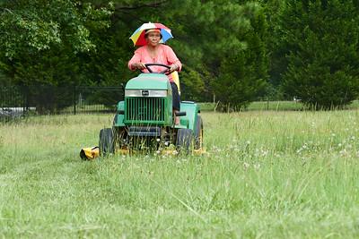 Dieu on her John Deere Tractor
