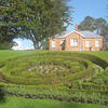 Jellicoe Park: Looking over the gardens to picnickers in front of The Blockhouse built in 1860.