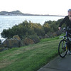 Josie enjoys a cycle ride along the newly revamped wharf cycleway. Mangere Mountain is behind.