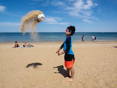 Raining sand on helpless sunbathers (apparently)