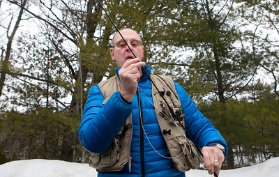 GRAND LAKE STREAM, Maine -- 04/01/2017 -- James Elliott Jr. ties a fly on his line before heading into Grand Lake Stream to enjoy opening day of open water fishing season in Grand Lake Stream Saturday. Ashley L. Conti | BDN