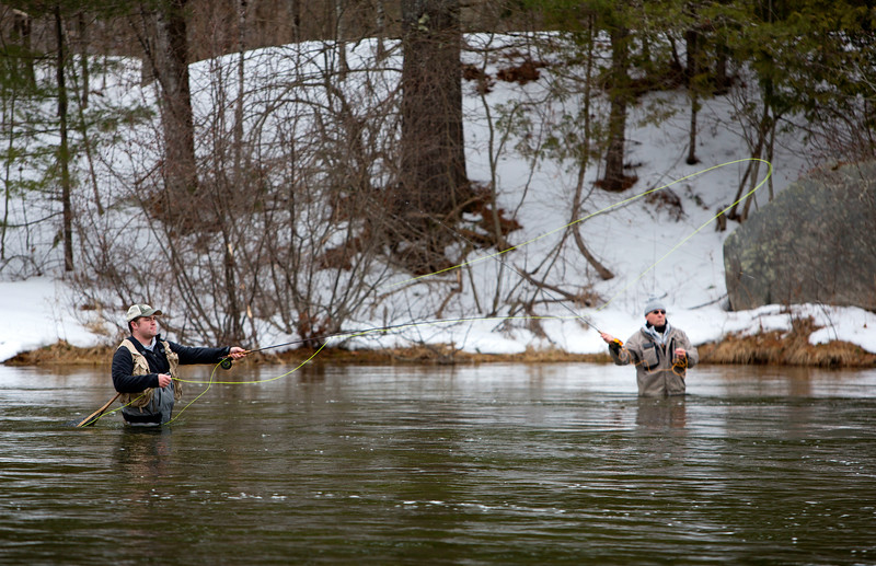 GRAND LAKE STREAM, Maine -- 04/01/2017 -- A fly fisherman casts his line into Grand Lake Stream during opening day of open water fishing season in Grand Lake Stream Saturday. Ashley L. Conti | BDN