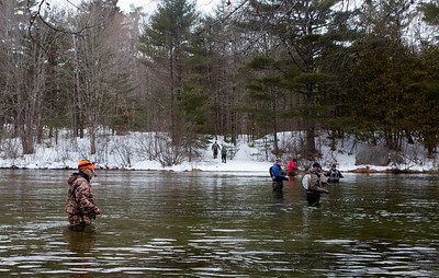 GRAND LAKE STREAM, Maine -- 04/01/2017 -- Dennis Perry (left) tries his hand during opening day of open water fishing season at Grand Lake Stream in Grand Lake Stream Saturday. Ashley L. Conti | BDN