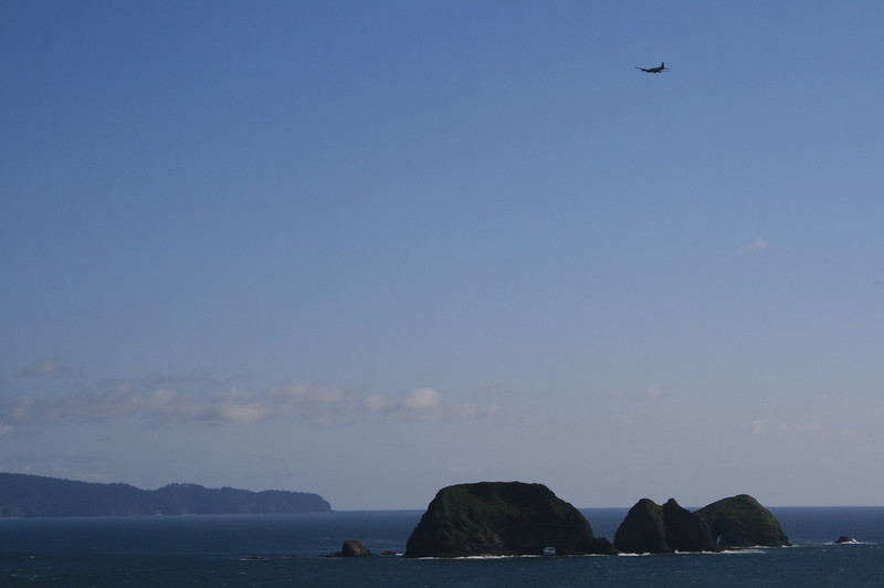The aircraft is a B17.  Just happened to be flying by.  A very rare bird, indeed.
