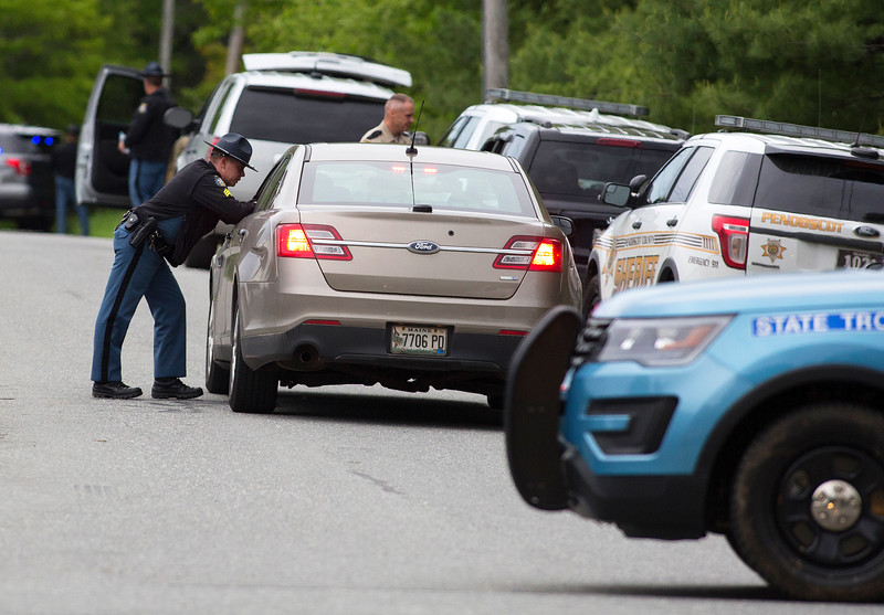 ORRINGTON, Maine -- 06/06/2017 - Maine State Police, Penobscot County Sheriff, and Brewer police work to talk to a man who reportedly barricaded himself inside his home near the intersection of Johnson Mill Road and Center Drive in Orrington Tuesday. Ashley L. Conti | BDN