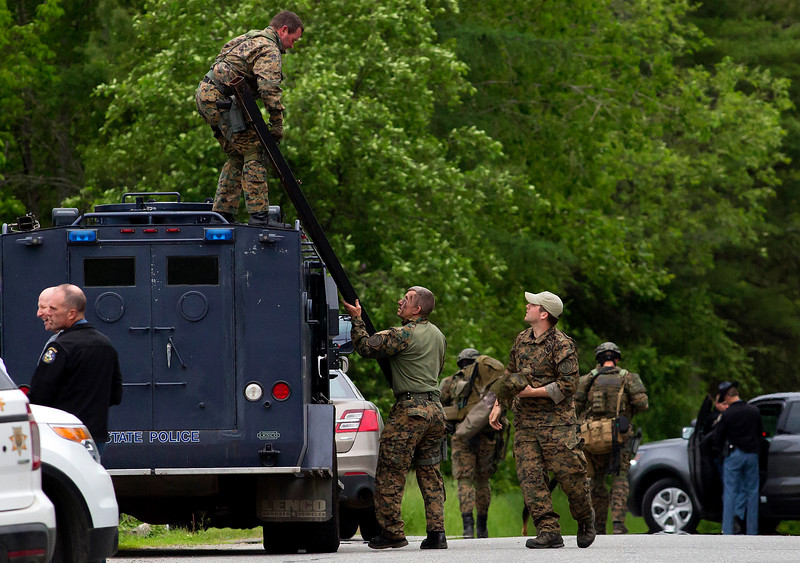 ORRINGTON, Maine -- 06/06/2017 - Maine State Police tactical team make their way to the home where a man reportedly barricaded himself inside his home near the intersection of Center Drive and Johnson Mill Road in Orrington Tuesday. Penobscot County Sheriff and Brewer police were also at the scene. Ashley L. Conti | BDN
