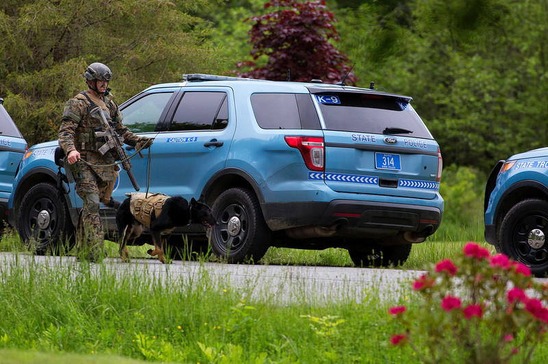 ORRINGTON, Maine -- 06/06/2017 - Maine State Police tactical team gear up to make their way to the home where a man reportedly barricaded himself inside his home near the intersection of Center Drive and Johnson Mill Road in Orrington Tuesday. Penobscot County Sheriff and Brewer police were also at the scene. Ashley L. Conti | BDN