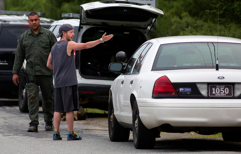 ORRINGTON, Maine -- 06/06/2017 - A concerned neighbor talks with emergency responders to see if he can check on his two puppies at his home while Maine State Police, Penobscot County Sheriff, and Brewer police work to talk to a man who reportedly barricaded himself inside his home near the intersection of Johnson Mill Road and Center Drive in Orrington Tuesday. Ashley L. Conti   BDN