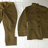 Grandpa Orville D. James' WWI uniform. The pants balloon out at the thighs like jodhpurs and the bottom buttons around the calf like knickers. The coat has the officers braid around the sleeve cuffs. There are still pin holes visible in the collar from when the insignia was attached.