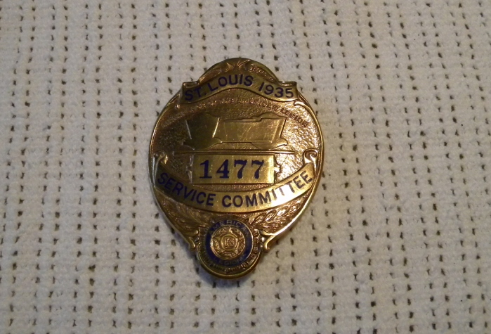 This was the committee badge he wore at the 1935 American Legion convention in St Louis, Mo.