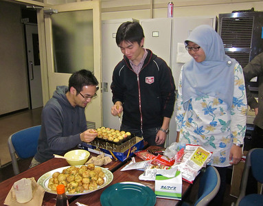 Students cooking takoyaki.