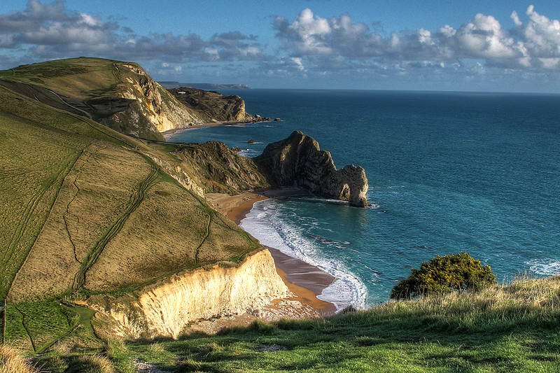 ... and down again from 98 metres to about 30 metres at Scratchy Bottom with the iconic Durdle Door beyond.