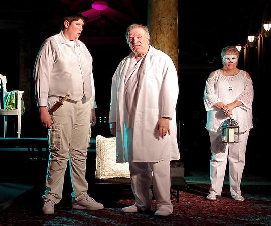 Mark Maynard | for The Herald Bulletin<br /> Roderigo (Martin Stapleton) and Brabantio (David Whicker) talk of Desdemona's relationship with Othello, as a Masque Player (Judy Pochard) provides lamp-light.