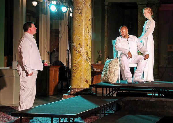 Mark Maynard | for The Herald Bulletin<br /> With Desdemona (Lauren Schaffter) standing by his side, Othello (Butch Copeland) addresses his lieutenant, Cassio (Andy Persinger).