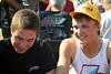 Logan Shuchart and Jacob Allen sign autographs for the kids before the races.