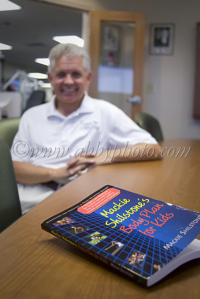 Mackie Shilstone and one of his many books