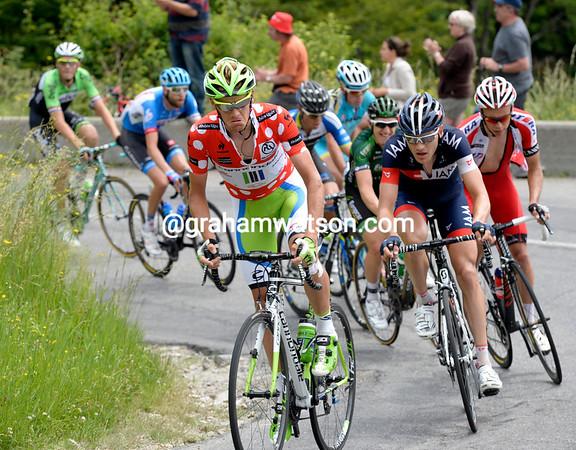De Marchi leads the escape up the Pas de Morgins - but his face shows the discomfort of chasing climbing points...