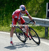 Luca Paolini overcooks a bend and nearly falls - a dozen others have already fallen higher up the mountain...