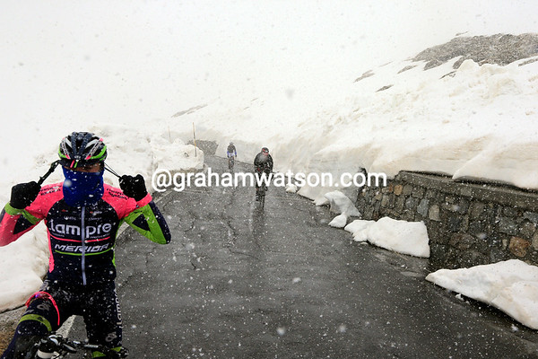 A Lampre cyclist stops to adjust his head-wear...