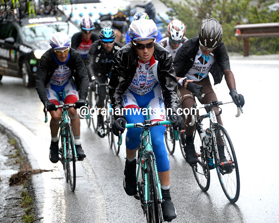 Diego Rosa leads a new escape that's formed on the descent of the Gavia - about ten men are climbing the Stelvio in front...